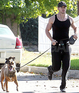 Pictures of Kellan Lutz Running With His Dog