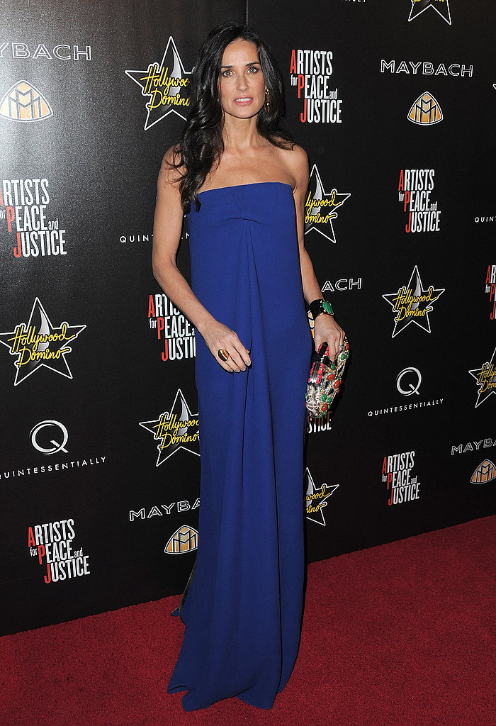 Demi stuns in a column, cobalt blue at a pre-Oscar party in March 2010.