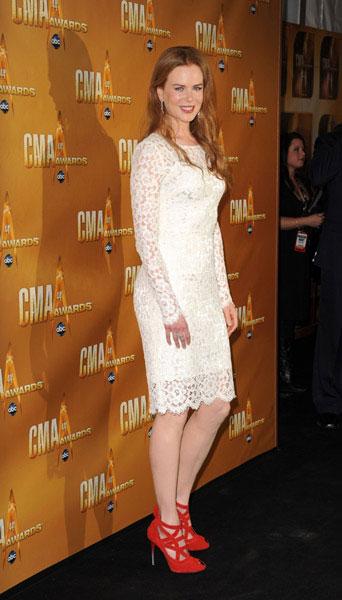 Nicole Kidman went for a demure hemline in a lacy Dolce & Gabbana with fiery L'Wren Scott heels.