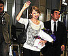 Slide Picture of Taylor Swift Touching Down in Japan