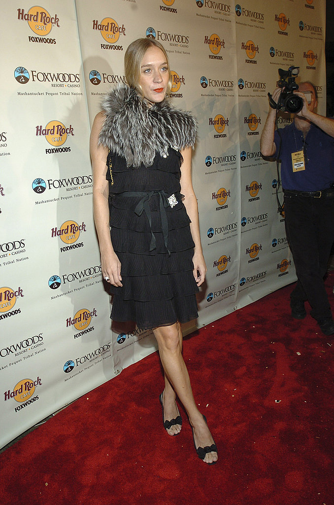 A fur capelet completes a ruffled black dress for an event in '04.