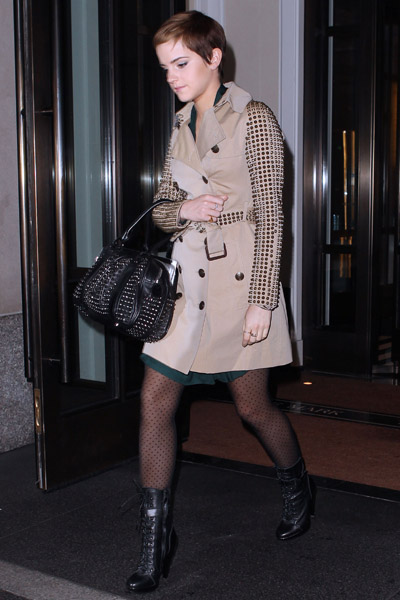 Emma Watson looked part tough, part chic in a studded Burberry trench and bag.