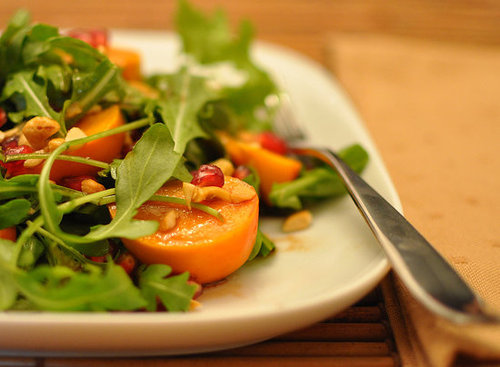 Arugula With Persimmons and Pomegranate Seeds