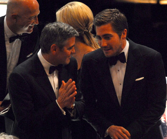 George Clooney chatted with Jake Gyllenhaal between commercials at the 78th Annual Academy Awards in March 2006.