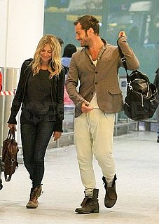 Pictures of Sienna Miller and Jude Law Arriving Back in London Together