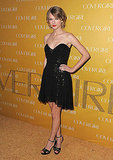 Taylor Swift donned a sparkly black Mark & James cocktail dress and strappy Dolce & Gabbana heels.
