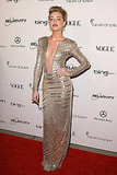 Actress Amber Heard in a deep cut metallic gown.