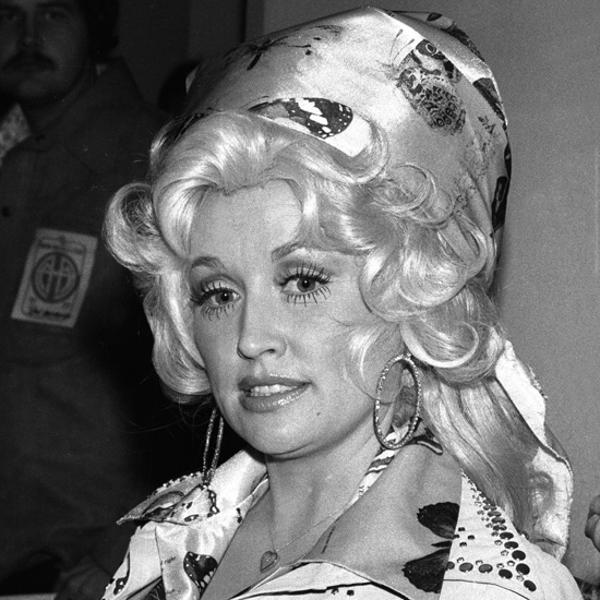 In the late 1970s, Dolly tried the classic Jackie O headscarf look, with much bigger, blonder results. Only Dolly could make a demure head wrap look so flamboyant.