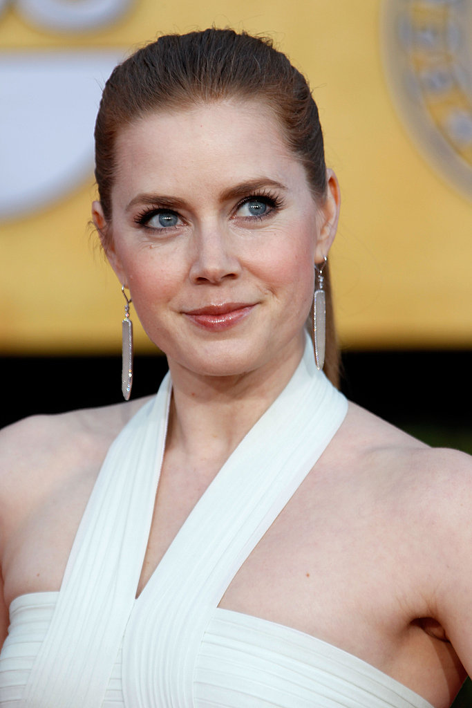Amy Adam's halter neckline was complemented by her silver spear-like earrings.