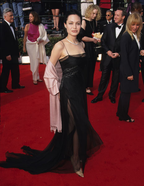 Angelina vamped it up in sheer black in 2000.