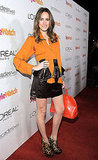 Louise Roe rocked the leather trend in a ruffled-adorned mini with a pair of leopard-print heels.