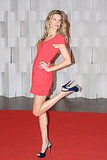 Gisele Bundchen Kicks Up Her Heels in a Hot Red Dress