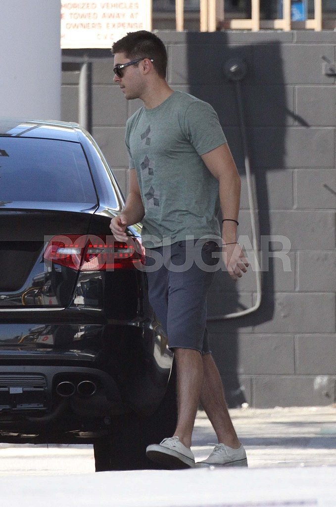 Zac Efron Multitasks While Pumping Gas
