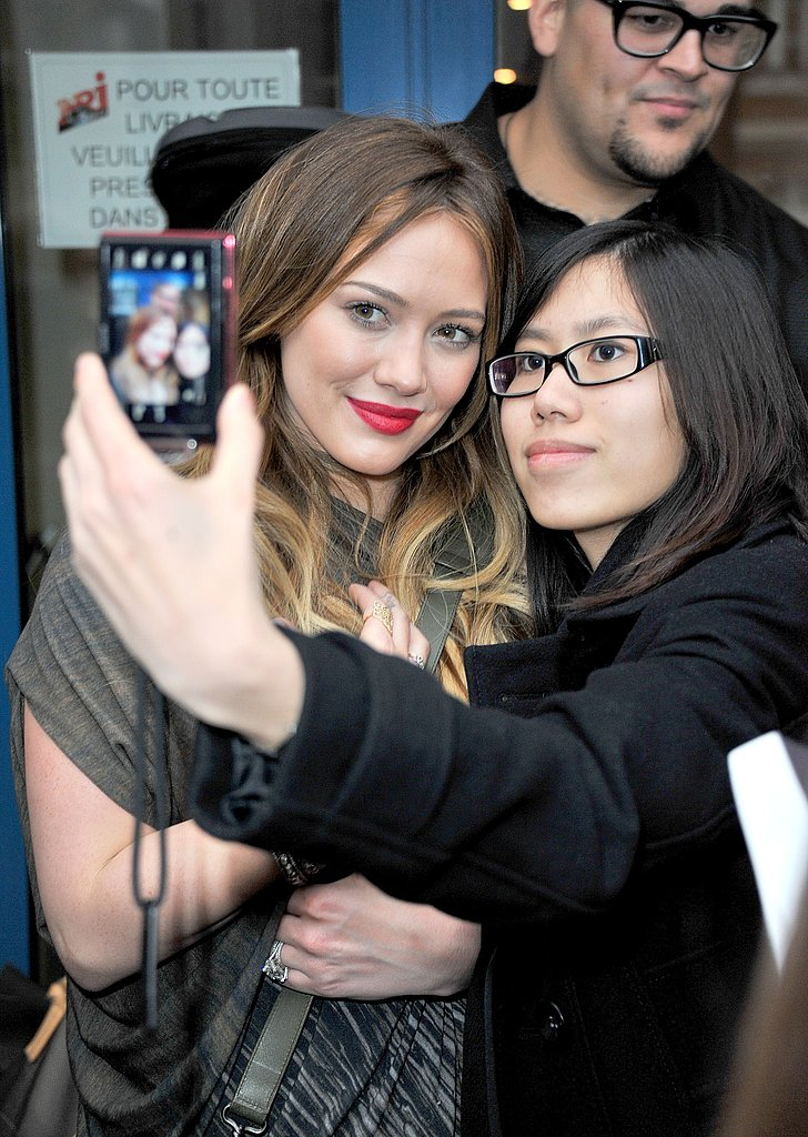 "Hilary Duff Makes ""Mikey"" Hold So She Can Pose For Fans"