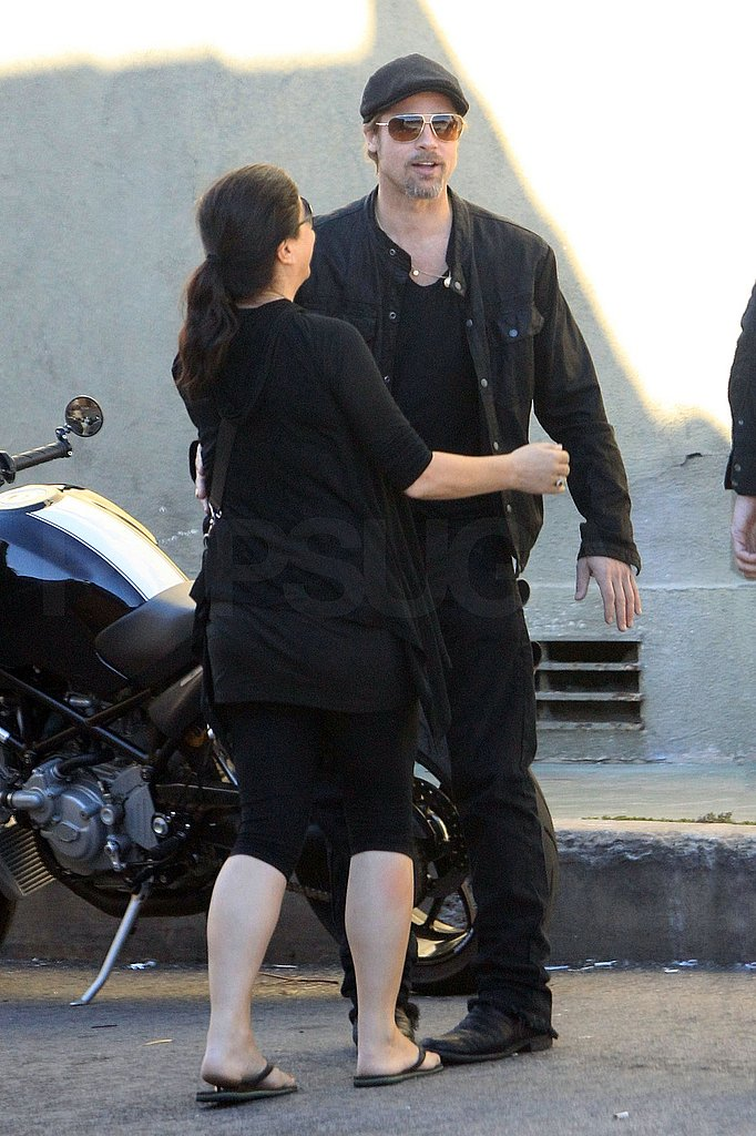 Brad Pitt Hugs His Lady Fans During a Smoke Break