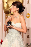 . . . while his wife Penelope Cruz copied his pose for best supporting actress for Vicky Cristina Barcelona in 2009.