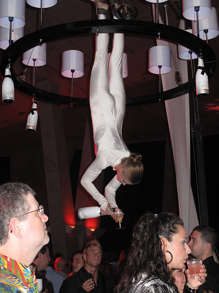 The party had all manner of acrobatics, including upside-down aerialists serving drinks. We couldn't get through the crowd to nab one. Oh well: there's always next year!
