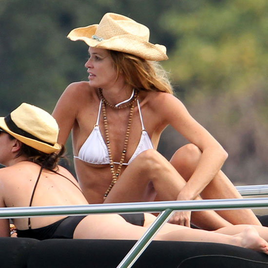 Elle Macpherson lounged in Sydney wearing a white two-piece in February 2011.