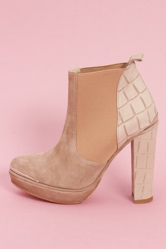 Opening Ceremony Nude Bootie ($168, originally $560) Why: Nude is huge for Spring, and it's done in a really cool way on these platform booties that will look amazing with pretty much everything you own. A great transitional shoe, too.