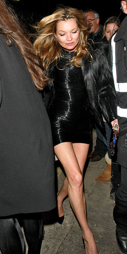 Kate Moss looked slick and sexy in a black mini and fur topper.