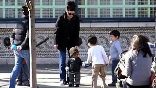 Video of Sandra Bullock With Son Louis at a NYC Park Teaching Him How to Walk and Make Friends