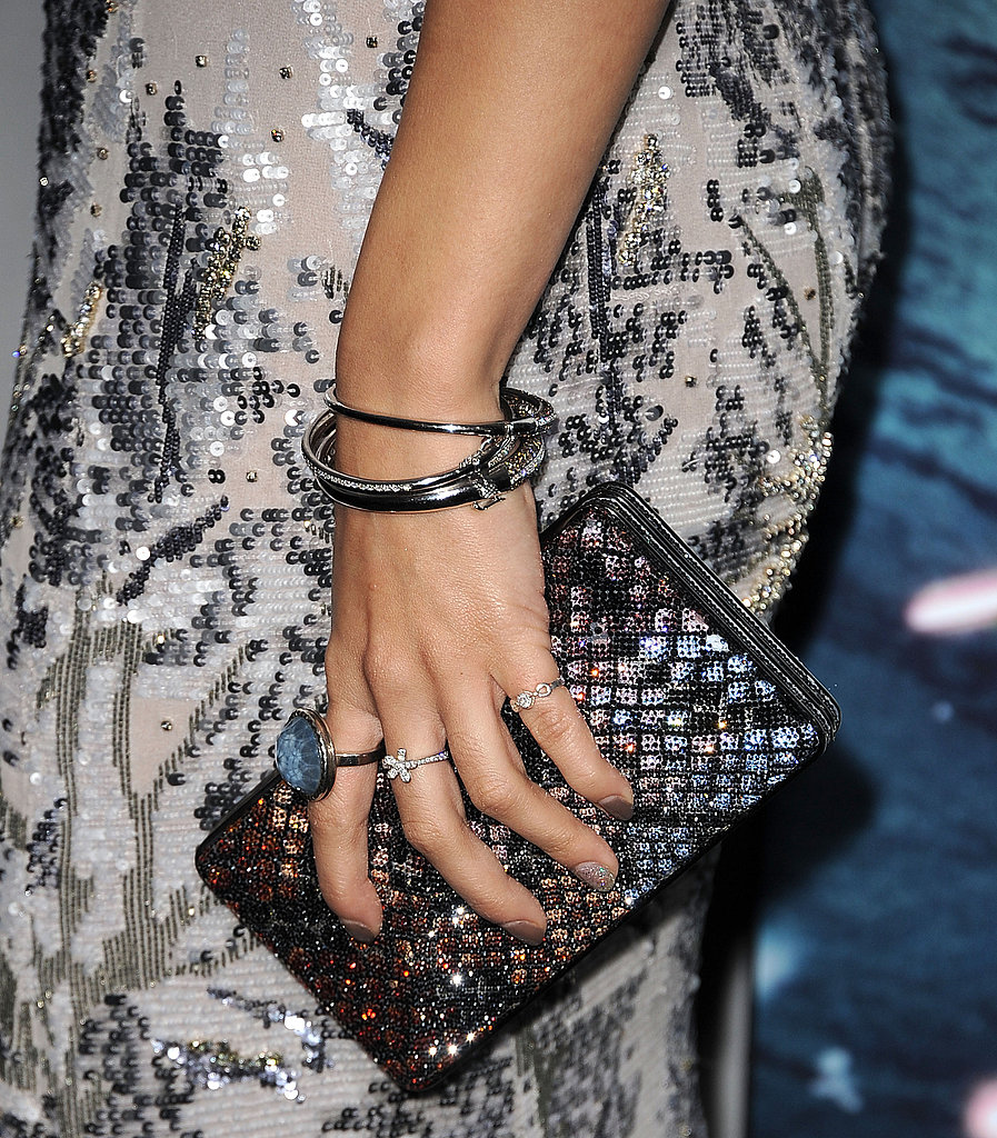 Stacked bracelets, multiple rings, and a textured clutch add a youthful spirit to her ensemble. Also, take note of the delicate beading detail!