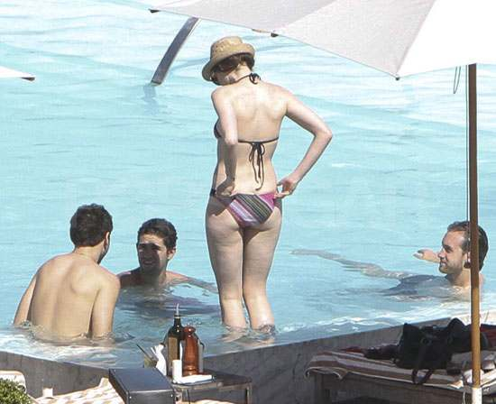 Anne Hathaway Slips Into a Bikini For Sexy Pool Time With Her Boyfriend