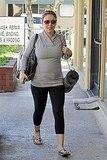 Alyssa Milano Shows Off Her Baby Bump in a Tight Top Amid Influential Tweets