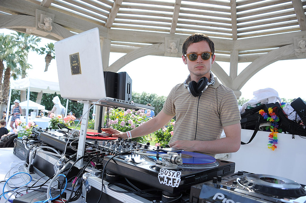 Elijah Wood provided the entertainment, playing DJ at Lacoste's desert pool party.