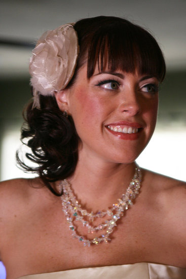 This bride's fun style featured blunt bangs and a floral hair accessory. Source: Flickr user quinn.anya