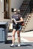 Reese Witherspoon Works Out While Rob Takes Care of WFE Duties