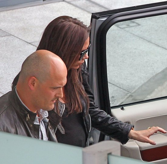 Victoria Beckham Shows Off Her Bump as She Lands in London For the Royal Wedding!