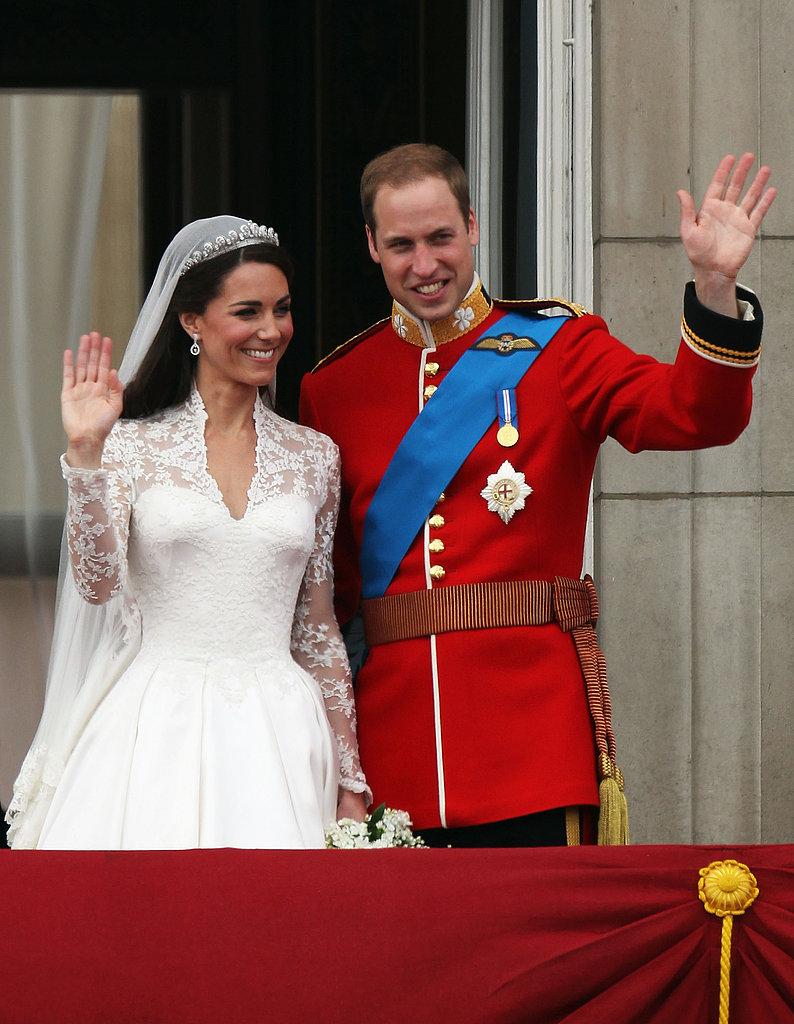 Prince William and Kate Middleton wave to the crowds.