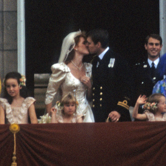 Sarah and Andrew lock lips at their royal wedding.