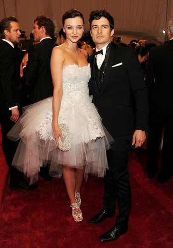 Miranda Kerr in Marchesa and Nicholas Kirkwood shoes with Orlando Bloom
