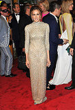 Sarah Jessica Parker sparkled in a beaded full-length gown from the late designer.