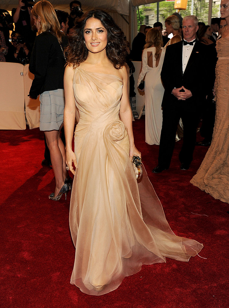 Salma Hayek kept things neutral in a wispy nude gown by Alexander McQueen.