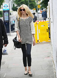 Claudia Schiffer showed off a slouchy striped sweater we're now coveting.