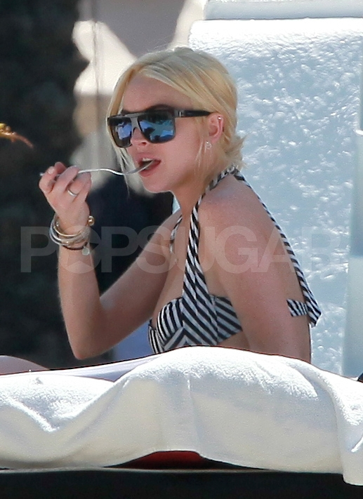 Lindsay Lohan Breaks From a Photo Shoot For Poolside Bikini Time