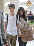 Justin and Selena Land Hand in Hand Following Their Billboard PDA