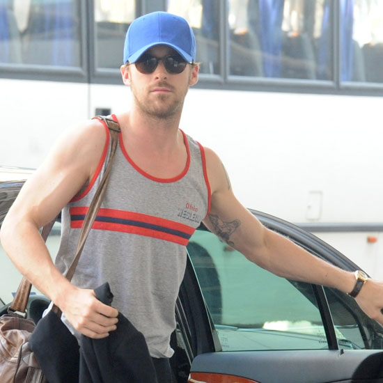 Ryan Gosling Reveals His Hot Muscles During a Goofy Airport Appearance