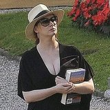Christina Hendricks Wears a One-Piece Bathing Suit While on Vacation in Italy