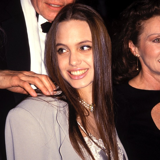 In 1991, a young Angelina, wearing her hair much the same as she does today, attended a play with her family.
