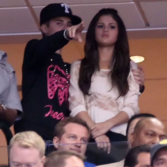 Justin Bieber had his arm around Selena Gomez at an NBA finals game in Texas in June 2011.