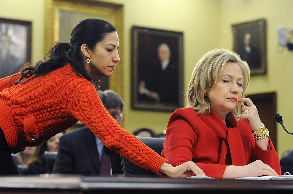 Huma slipped Hillary Clinton a note during a heading in Congress in 2011.