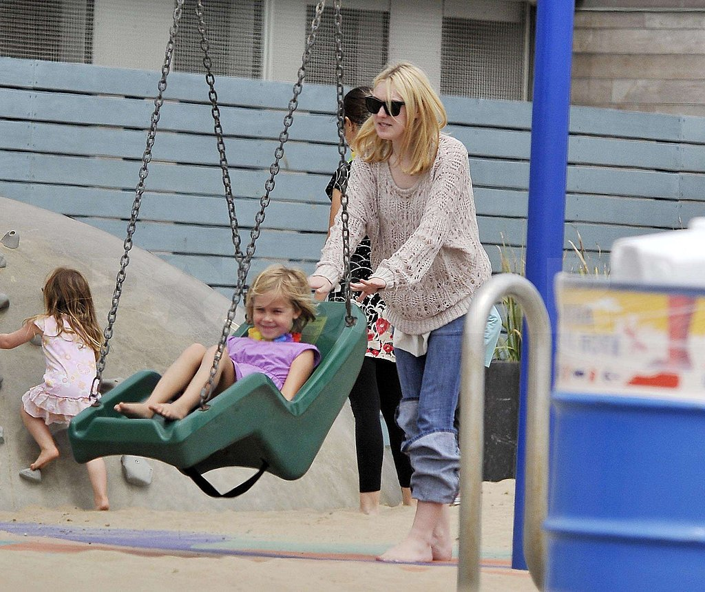 Dakota and Elle Fanning Splash Around During a Fun Family Day at the Beach