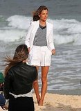 Alessandra Ambrosio Strikes a Pose in a Bright Suit on the Sand