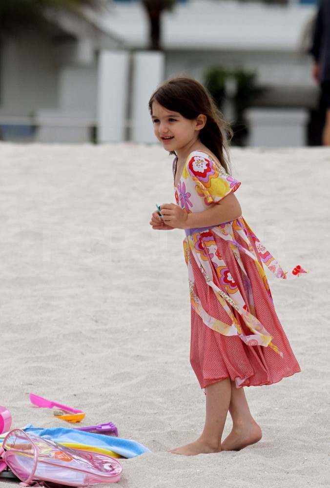 Katie Holmes Hits the Beach in Her Bikini and Splashes in the Waves With Suri