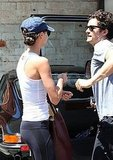 Orlando Bloom and his wife Miranda Kerr chat in LA.