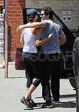 Orlando Bloom gave his wife Miranda Kerr and hug.